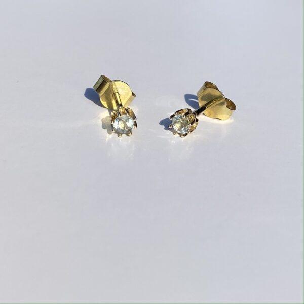 Guld oerestik med akvamarin